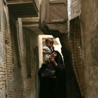 A woman holds her child from Iraq