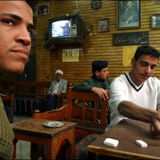 Young Iraqis playing dominoes